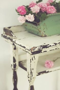 """chippy white table withwith hand made flower container...Love """"old""""."""