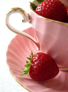 teacup full of strawberries