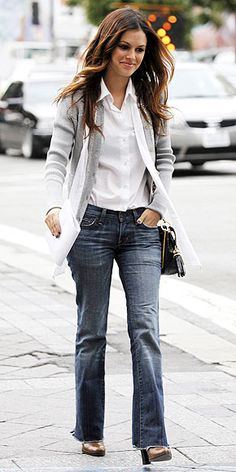 Rachel Bilson in a heather gray cardigan to her white button-down, faded jeans and metallic pumps.