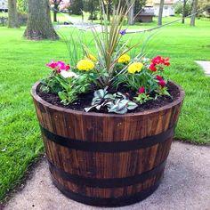 Wine barrel flower planter for small flowers #diy #winebarrel #flowerplanter #repurpose #decorhomeideas Patio Planters, Fall Planters, Flower Planters, Flower Pots, Rustic Planters, Wood Barrel Planters, Rustic Patio, Planter Garden, Decorative Planters