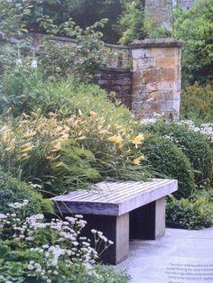 Dan Pearson Cotswolds garden including Hemerocallis citrina, Astrantia, Buxus & Alliums.