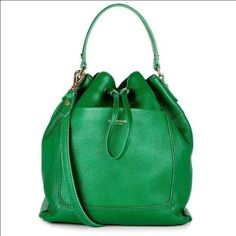 "Isaac Mizrahi Green Bucket Crossbody Bag Super cute and totally chic bucket bag. Perfect for the summer! I bought this and never used it. 8.63""L x 3.75"" W x 10""H. 25"" strap with adjustability. 100% genuine leather. Features 1 exterior slip pocket, 2 interior slip pockets for cell phone etc., and 1 interior zip pocket. Comes with dust bag. Perfect condition and NWT. Isaac Mizrahi Bags Crossbody Bags"