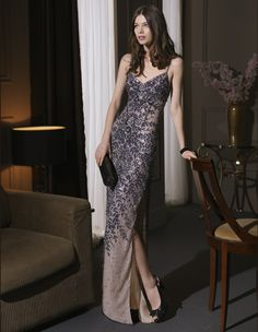 A beaded evening gown with a modestly sexy slit from the 2014 Aire Cocktail Collection by Rosa Clará.