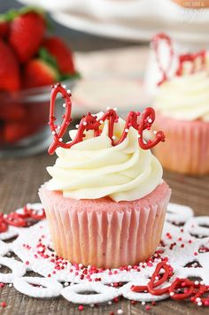 Strawberry Cupcakes with Cream Cheese Frosting - the love toppers make them the perfect treat for Valentine's Day!