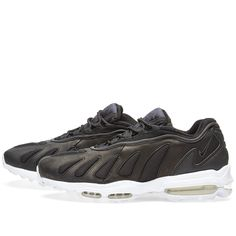Two decades and counting, NikeLab resurrect a 1996 release in honour of its 20th anniversary. Borrowing the outsole from the coveted Air Max 95, the Air Max 96 maintains its revolutionary ride with the same classic cushioning as the original. Now released in black and white, the lightweight synthetic leather and mesh uppers offer breathability with overlay straps for a glove-like fit.  Lightweight Synthetic Leather Mesh Underlays Reflective 3M Accents Air Max Heel Integrated Lacing Rubber…