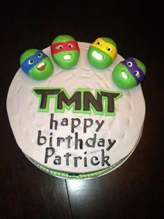 Teenage Mutant Ninja Turtles Cake  Vanilla cake with a Cookie Dough center. Yum-o! Vanilla buttercream frosting and fondant decorations