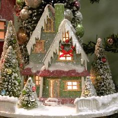 KD Vintage Traditional Christmas House III - Made of cardboard and glitter Features snow-covered roof and accented Christmas trees Finished in red, green, and white Weighs 0.8 pounds...