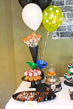 Car - Dessert Table - food ideas- speed bumps, pot holes, white wall tires, items displayed in an air filter and funnels