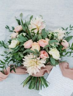 Beautiful bouquet with greenery and garden roses.