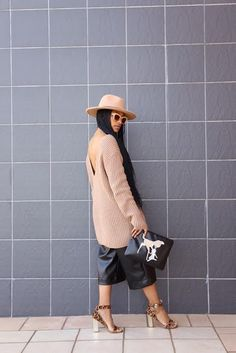 Camel fedora and oversized v-back knit with black leather culottes