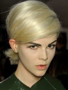 Another 2013 Hair Trend seen on the catwalk - 60s with a modern twist. Up do's with edge!...it's actually a low messy yoga bun