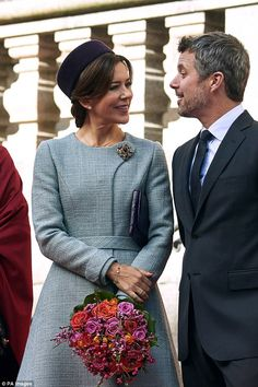 Crown Prince Frederik - impeccably attired in a classic charcoal grey three piece suit