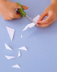 Cut the folded paper with variations of straight and curvy lines. Get creative with your snowflake designs by experimenting with different sizes and shapes of cutouts.