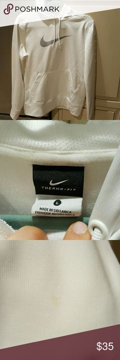 WHITE NIKE THERMA FIT SWEATSHIRT Nike white sweatshirt in very good condition. HOODIE AND POCKETS.  There is one light stain on the back of the yellow sleeve that is shown in 3rd pic. JUST DO IT goes across the left sleeve as shown on pic. Nike Sweaters