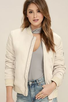 Keep your cool even when the weather's chilly with the Chillax Beige Bomber Jacket! Sleek woven poly forms this trendy padded bomber with thick ribbed knit around the cuffs, collar, and waist. Silver zipper at front, plus flap pockets with snaps.