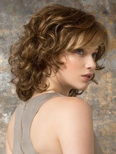 Wigs Women - Cat by Ellen Wille is a mid-length wavy wig with a wispy bang. The hair transitions from straight on top to gentle waves and loose curls. #BangsHairstylesCurly