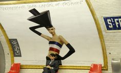 """""""I took this picture in the Paris Metro: It looks like the model is doing all she can to attract the gentleman's attention, but he is oblivious to her flirtations."""" (From: 40 Stunning Photos of France) #travel #budgettravel #France #Paris #artsy #metro #signs BudgetTravel.com"""