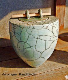 Turned pot form by Veronique Kandlbinder ,raku fired.
