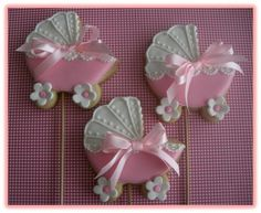 Butter cookies covered with royal icing, fondant accents