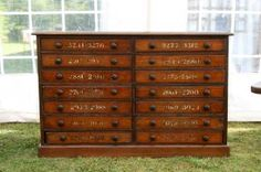 19th century spice cabinet with numbered drawers         ****