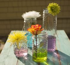 Just add sun! Your water, tinted with just a touch of food coloring, will become radiant when the sun's rays cast through it. With the knobbed texture of our Hobnail Vases, the colors ripple and glitter. #RainbowWedding #ColorfulFlorals