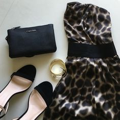 Grrrr! Bringing Sexy Back H&M Dress Super cute animal print, sleeves mini dress by H&M. NWT. Dress and lining are both 100% Polyester. Black elastic waistband. Comes with animal print straps, but can be worn strapless as well. Gorgeous little dress! Calvin Klein clutch and gold bracelets each sold in a separate listing. H&M Dresses Mini