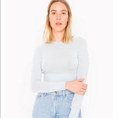 Light weight crop sweater Ice blue colored, tight fit, super soft, & really cute. Never been worn but no tags because I bought it online. I'll post photos if you're interested American Apparel Tops Crop Tops