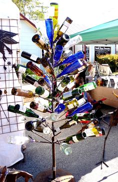 I am currently making a wine bottle tree for my Aunt. It is similar to this but much better crafted. Now just need to save the wine bottles up! Wine Tree, Wine Bottle Trees, Empty Wine Bottles, Wine Bottle Crafts, Bottle Art, Glass Bottles, Crafts With Glass Jars, Backyard Plan, Bottle Display