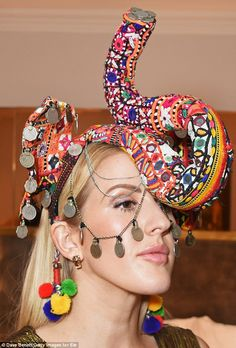 Beautiful: The pop princess cut a regal figure in a striking elephant headpiece featuring colourful patchwork embroidery and bold pom pom detailing