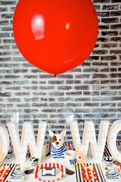 Love the giant red balloon! French Bulldog and Friends dog birthday party by Karas Party Ideas | KarasPartyIdeas.com with FREE PRINTABLE PLACE CARDS, TAGS, BACKDROP, SIGNS AND MORE!