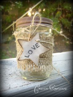 something like this for the baby food jars with a votive. Burlap with a holiday saying - peace or joy.