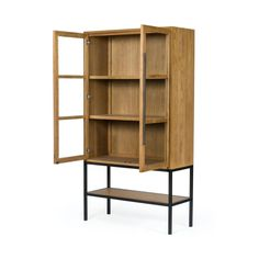 """Solid oak and black-finished iron fuse for a straightforward look with impact. Glass-front doors offer a peek inside to favorite books and treasures, with lower open shelving for even-more styling options. Overall Dimensions:47.00""""w x 19.00""""d x 86.50""""h Glass Front Door, Front Doors, Open Shelving, Shelves, Classic Cabinets, Solid Oak, Bookcase, Iron, Black"""