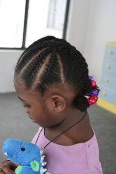 cornrows into french plaits. I like the slanted parts