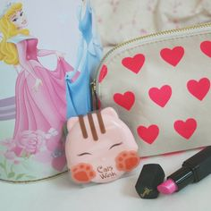 So excited about that cute Cats Wink powder I just got!!!! How adorable is the kitty packaging?!!! #barrym #pinklipstick #aurora #disney #koreancosmetics #catswink #kitty #cute #cosmetics #korean #lipstick #disneyprincess #adorable #cosmeticbag #forever21 #pink