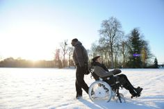 Still of François Cluzet and Omar Sy in The Intouchables