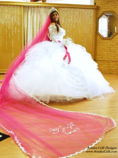b8147da87d1e White Chantilly lace and tulle gypsy wedding dress with hot pink satin sash  and sparkling crystal accents. Designed by Sondra Celli.