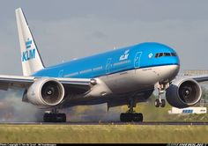 A hard smoky landing for this KLM 777 battling the crosswinds at Schiphol