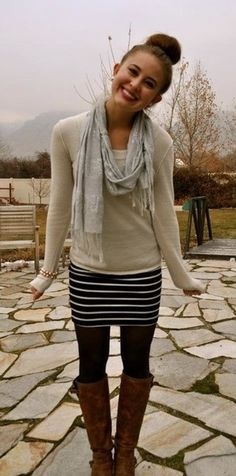 It's-supposed-to-be-Spring-but-isn't outfit. Long sleeve oatmeal pullover, black with white horizontal stripe short skirt, loose light gray neck scarf, dark tights, brown knee high boots.