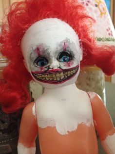 Homemade creepy clown doll, took a doll from the thrift store for a dollar        By: danika kloiber & dan kloiber