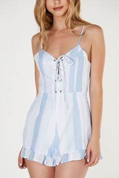 Chic printed romper with stripe patterns throughout for a nautical vibe. Ruffle trim at hem with lace up design in front and hidden back zip closure. Side pockets and adjustable shoulder straps.