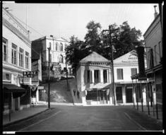 View down an unidentified street in Nevada City, California, showing Jackson's Grocery, ca.1930 (1900?) :: California Historical Society Col...