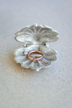 @BHLDN Weddings seashells ring holder for a coastal wedding, Photo by @NLP Weddings