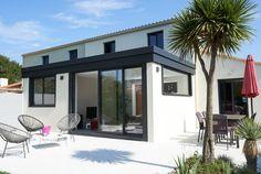 Véranda à toit plat pour une maison de bord de mer - Réalisation Fillonneau