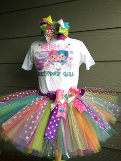 A personal favorite from my Etsy shop https://www.etsy.com/listing/280082488/baby-girl-shimmer-and-shine-colorful