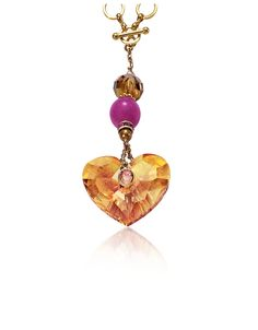 Designed by Manish Arora to represent the different elements of love, the Truly in love pendant features an astral pink colored heart that can be removed and worn with any necklace in the collection.