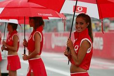 Vodafone grid girls during the drivers parade.  Formula One World Championship, Rd15, Italian Grand Prix, Race Day, Monza, Italy, 12 September 2004