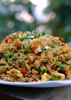 Chaulafan de pollo is an Ecuadorian chicken fried rice made with rice, chicken, bacon, onions, garlic, peppers, bell peppers, peas, carrots, scrambled eggs, raisins, spices and herbs.