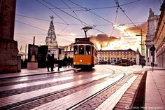 Terreiro do Paço square at the dawn, bording the Tagus River, while the tram passes by, lovely #Lisbon #Portugal