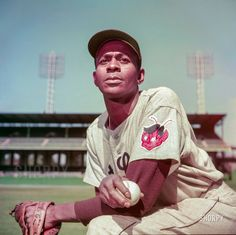 """Sept. 1952. """"St. Louis Browns pitcher Satchel Paige."""" Sporting Brownie the Elf. Kodachrome by Look magazine staff photographer Bob Lerner."""