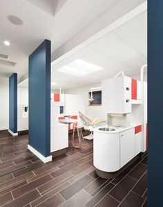 Children's dentist office. Mod style, bright colors + white cabinets